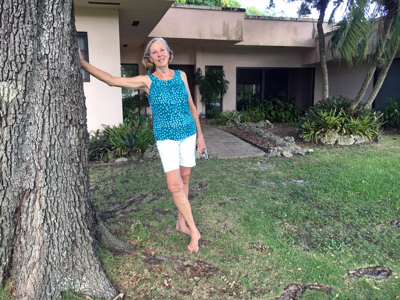 Nanci Mitchell stands outside her house in South Dade in 2017.