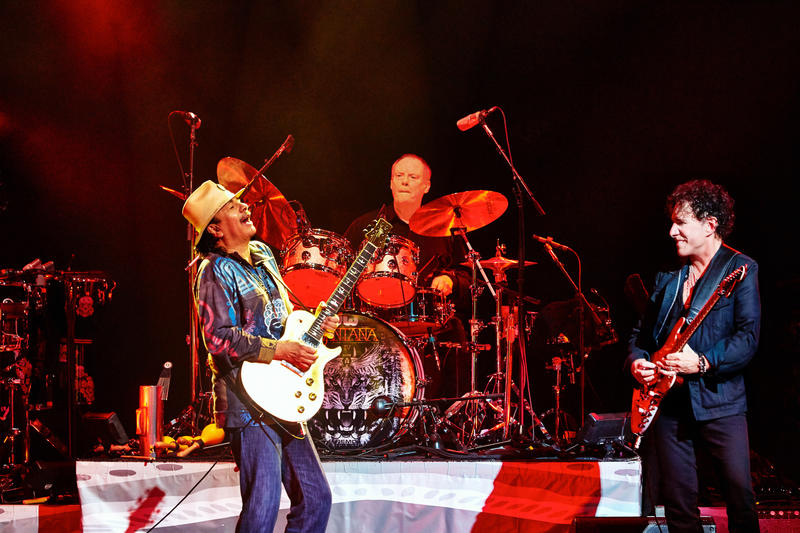Carlos Santana on stage with original band members.