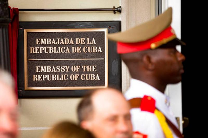 A guard stands at the entrance of the newly opened Cuban embassy in Washington D.C. in 2015.