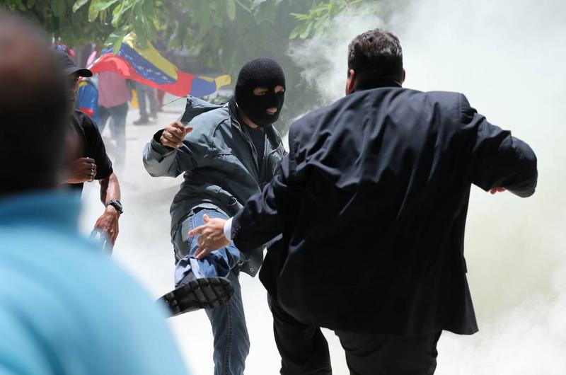 THE REAL ALT-LEFT: A member of pro-government enforcer groups known as colectivos attacks an opposition politician outside Venezuela's National Assembly in Caracas this summer.