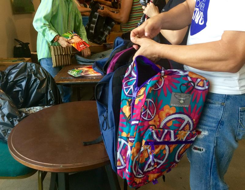 Volunteers from Unity by the Bay took the day off to stuff backpacks.