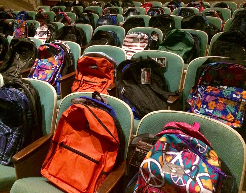 Chairs usually used for the congregation converted to backpack storage.
