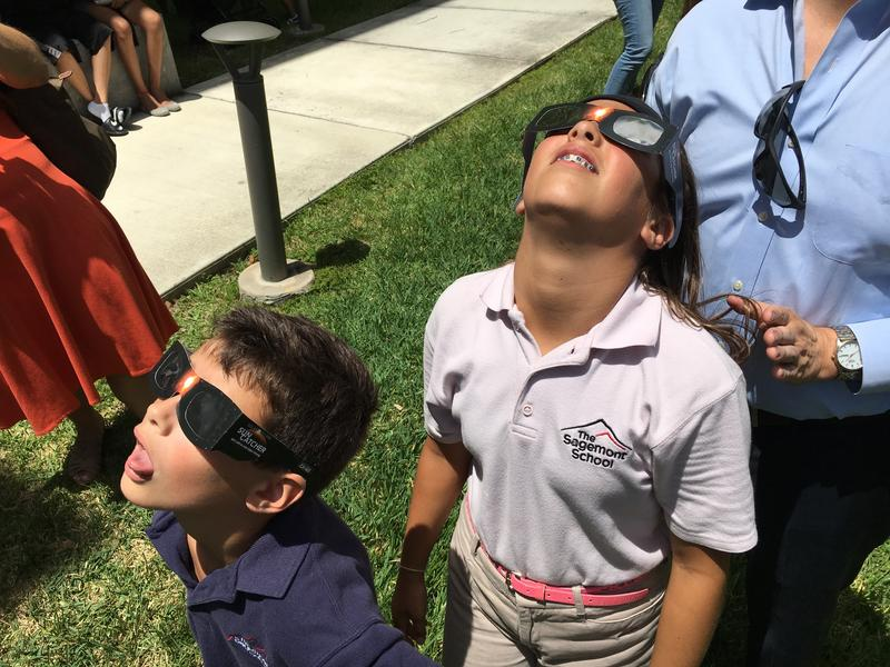 Eclipse viewers gathered at various events in South Florida, including the eclipse party at FIU's Stocker Astroscience Center.