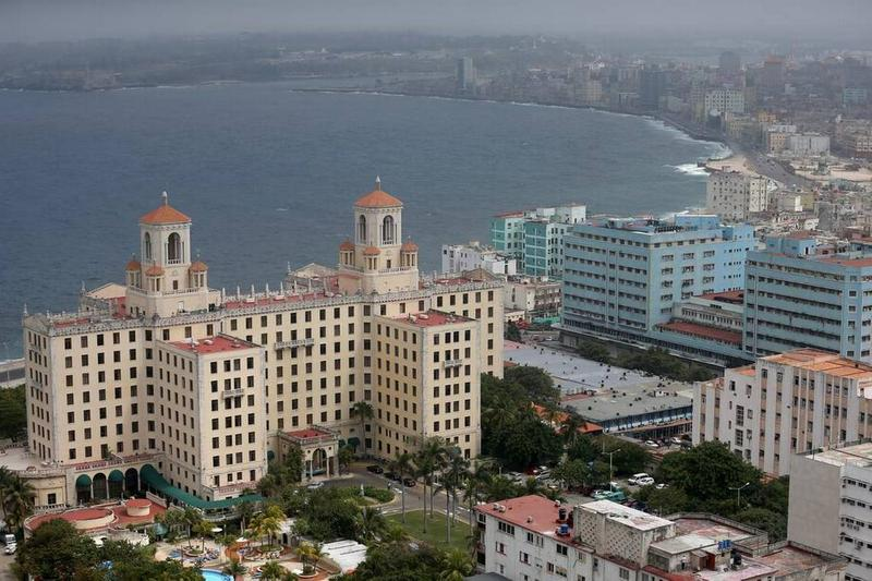 Three popular restaurants along Havana's seaside Malecon were closed recently, apparently for pushing free enterprise beyond legal boundaries. The historic Hotel Nacional de Cuba is seen in the foreground of this early morning picture.