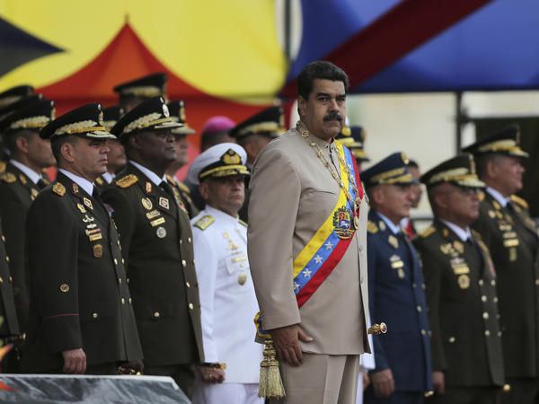 Venezuela's President Nicolas Maduro watching a military parade during Army Day celebrations at Fort Tiuna in Caracas, Venezuela.