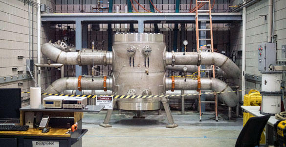 The new world-record magnet connected to cooling water pipes. Some 4,275 gallons of cold water flush through it per minute to keep it cool.