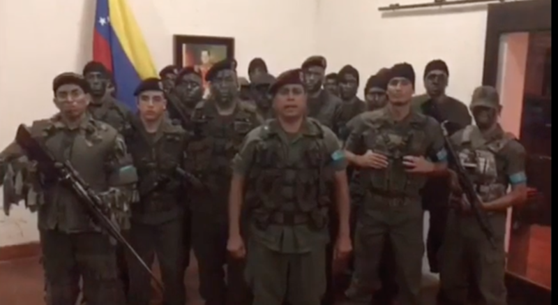 Venezuelan Army Capt. Juan Caguaripano (center) with other rebellious soldiers in a video they recorded before revolting at a military base in Valencia Sunday morning.