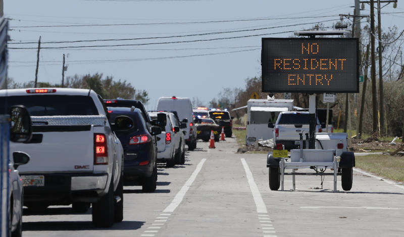 Motorists line up to enter the Keys at a checkpoint in the aftermath of Hurricane Irma, Thursday, Sept.14, 2017, in Florida City.