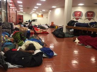 Evacuees in the atrium of Miami Edison Senior High School.
