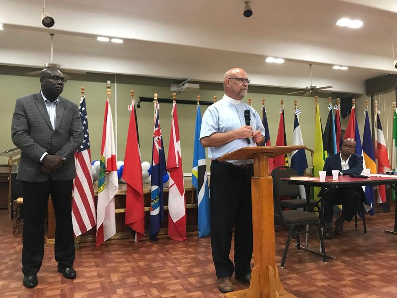 A U.S.  flag and flags representing each Caribbean nation were the backdrop for the meeting to coordinate aid to the islands after hurricanes Irma and Maria.