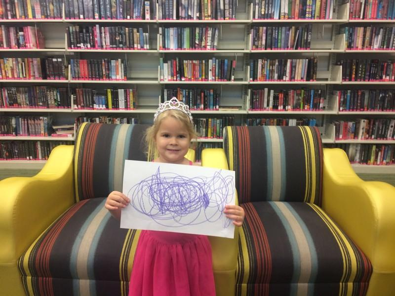 McKinley Markham, 4, holds up her drawing of Hurricane Irma at the downtown Boca Raton library on Wednesday.