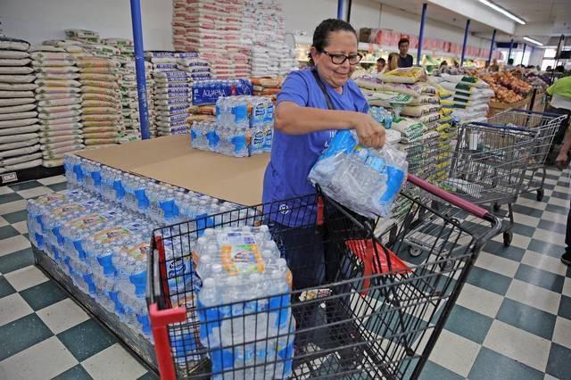 Daniela Garcia stocks up on water at Presidente Supermarket on Calle Ocho in Little Havana, on Monday, September 4, 2017.