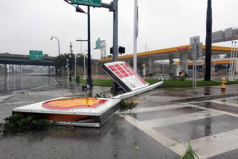 A Shell gas station sign fell Sunday at the corner of Northwest 36th Street and Biscayne Boulevard.