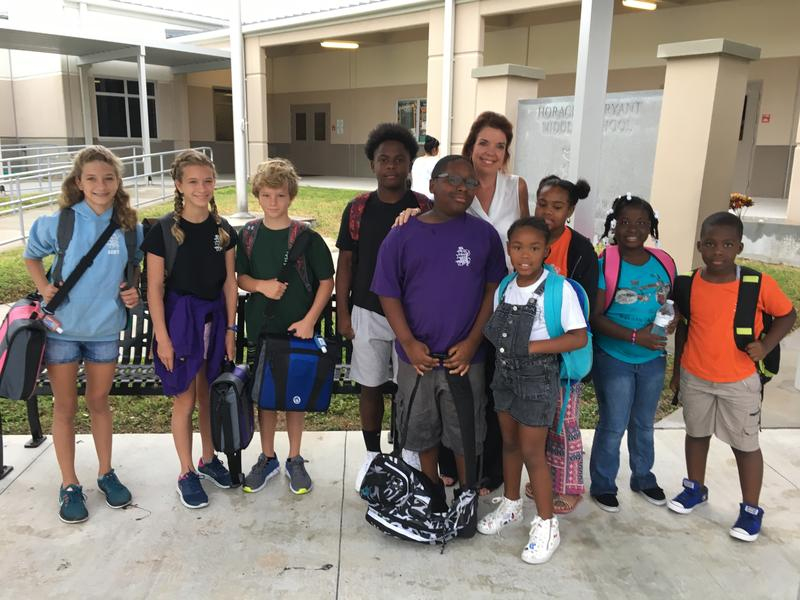Principal Christina McPherson greets students returning to Horace O'Bryant School in Key West Wednesday. It was their first day back after Hurricane Irma.