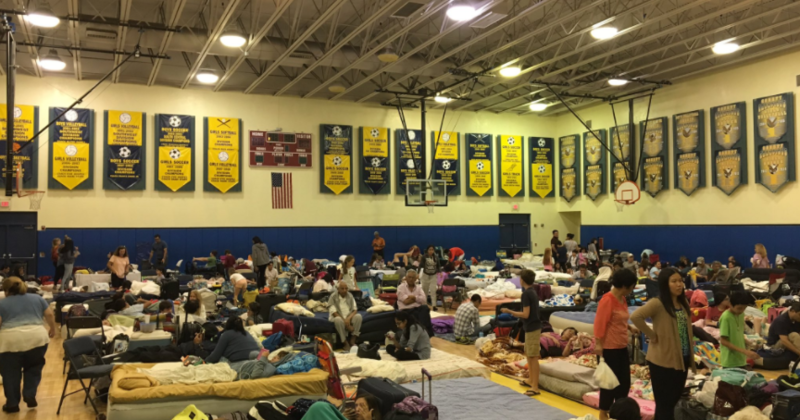 Evacuees get ready to pass the night at Falcon Cove Middle School in Weston.