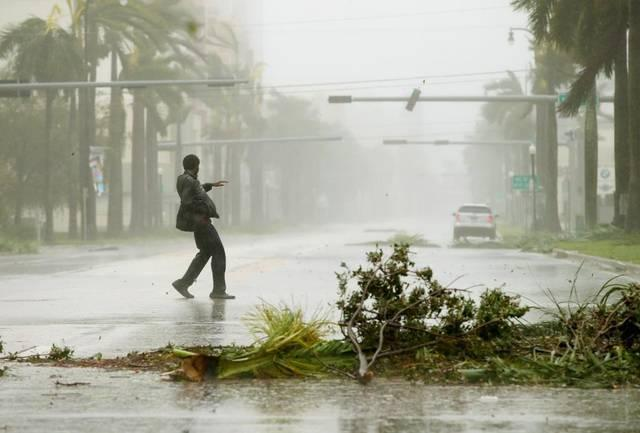 A man attempts to keep his balance in high winds  on Biscayne Boulevard in Miami during Hurricane Irma.