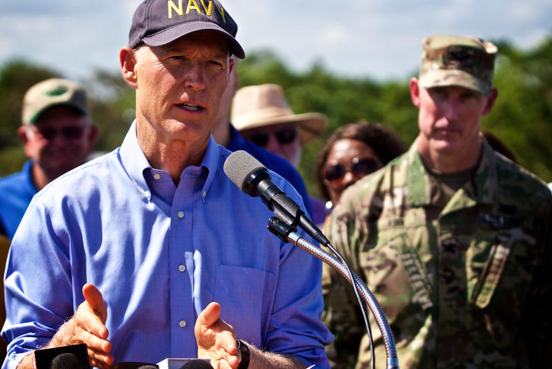 Florida Gov. Rick Scott, left, and U.S. Army Corps of Engineers Col. Jason Kirk address concerns about the Herbert Hoover Dike in Clewiston on Oct. 9, 2017.