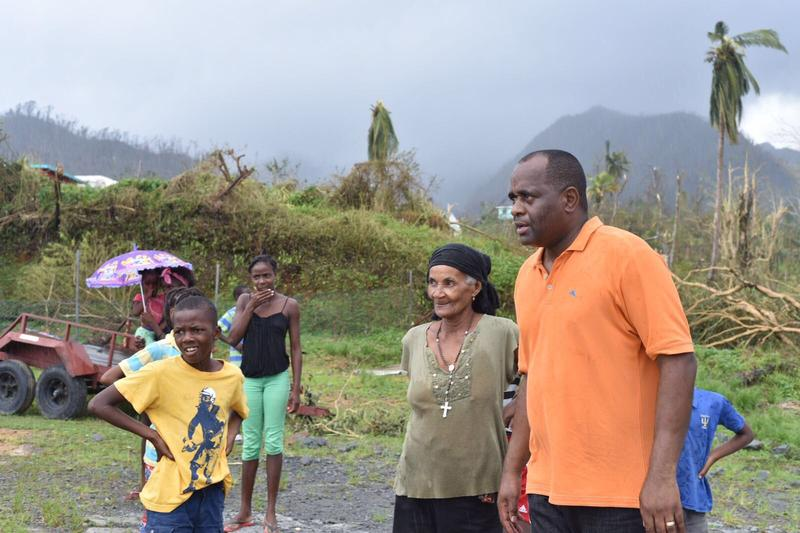 Dominica Prime Minister Roosevelt Skerrit (right) surveying his island nation's destruction after Hurricane Maria last month.