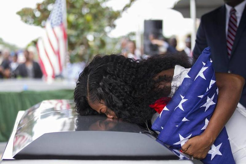 Myeshia Johnson kisses the casket of her husband, Sgt. La David Johnson, during his burial service at Fred Hunter's Hollywood Memorial Gardens in Hollywood, Florida on Saturday, Oct. 21, 2017.