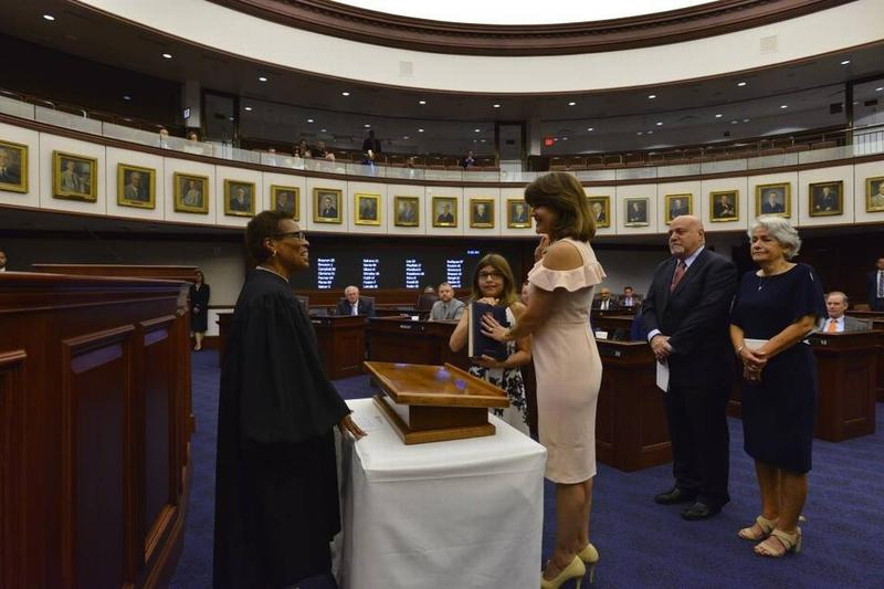 State Sen. Annette Taddeo (center) was sworn in to office by Florida Supreme Court Justice Peggy Quince.