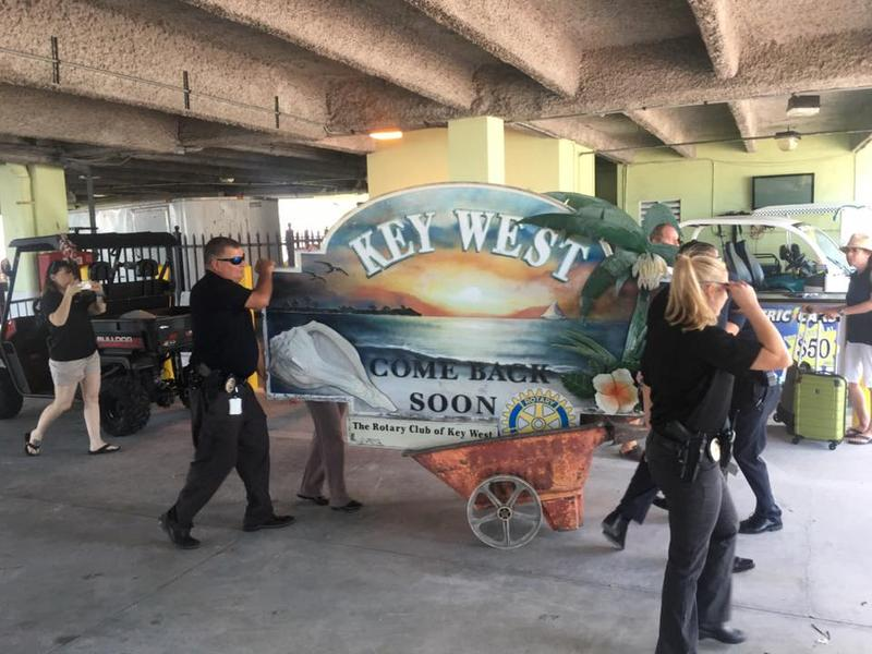 The sign, which reads 'Welcome to Key West' on one side and 'Come Back Soon' on the other, returned to the island Thursday via ferry.