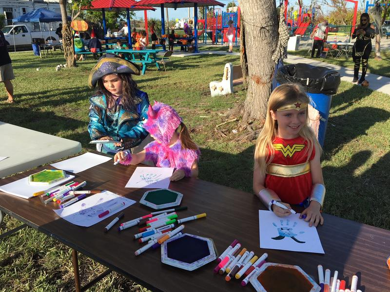 Keys kids work on making monster crafts at the Debris-Free Trick-or-Treat party on Bay Point Tuesday.