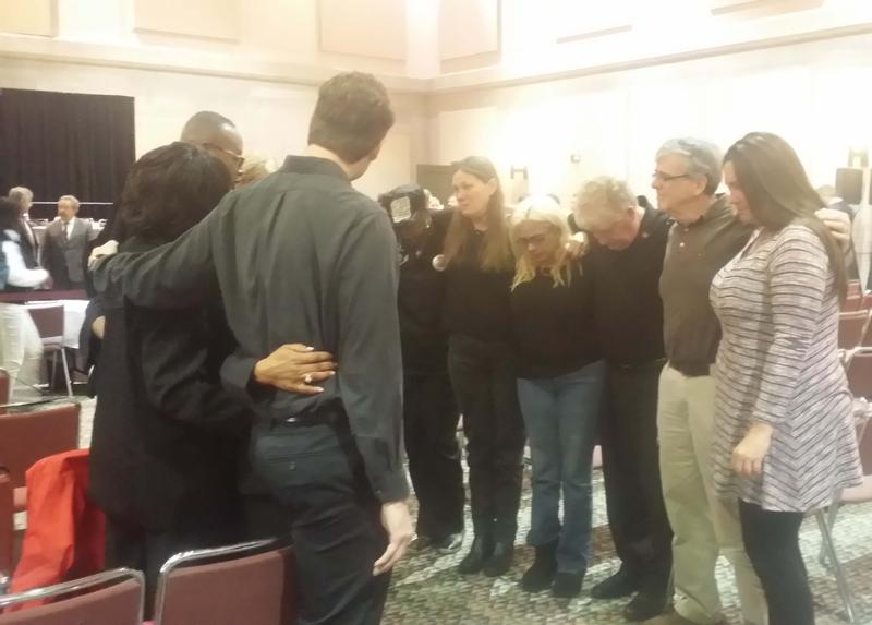El Faro families praying at the end of the final Coast Guard hearing in February.