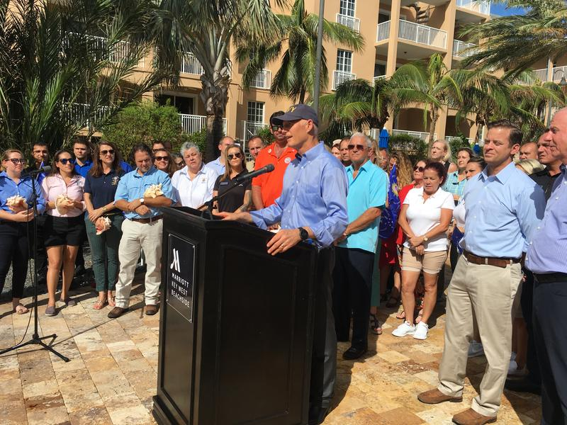 Gov. Rick Scott returned to Key West Wednesday with a high-powered state contingent including the lieutenant governor and the CEOs of Visit Florida and the Florida Restaurant and Lodging Association.