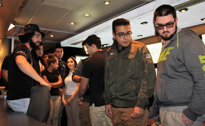 Students get a tour of the bus from on-board engineer Gabe Smith, left.