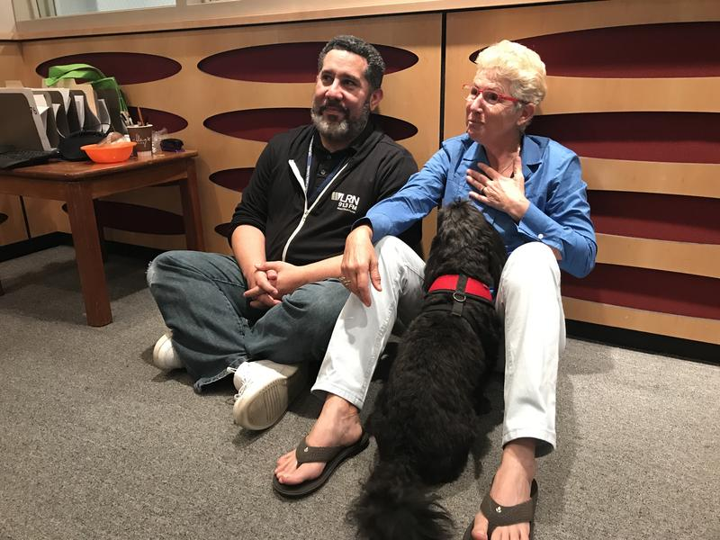 Sudial Host Luis Hernandez talking with Uli Shackman and her dog Jackson.