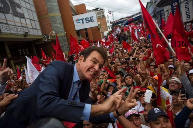 Opposition Alliance candidate Salvador Nasralla greets supporters in Tegucigalpa the morning after Sunday's presidential election in Honduras.