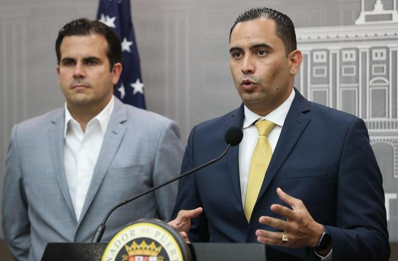 Puerto Rico emergency management director Abner Gomez (right) at a recent hurricane recovery press conference in San Juan with Governor Ricardo Rossello.