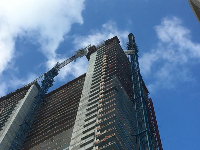 The broken crane rests on the top of the Gran Paraiso building in Edgewater.