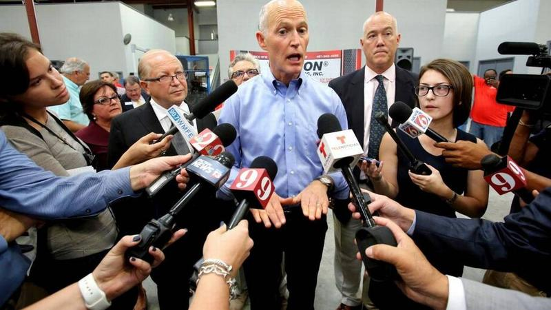 Gov. Rick Scott speaks during a tax cut announcement earlier this month.