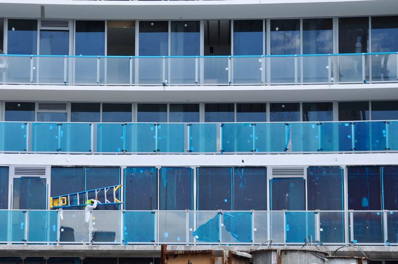 A subcontractor at work on the windows of the Auberge Beach Residences in Fort Lauderdale. About 25,000 fewer people work in  South Florida construction now compared to a decade ago despite the rebound.