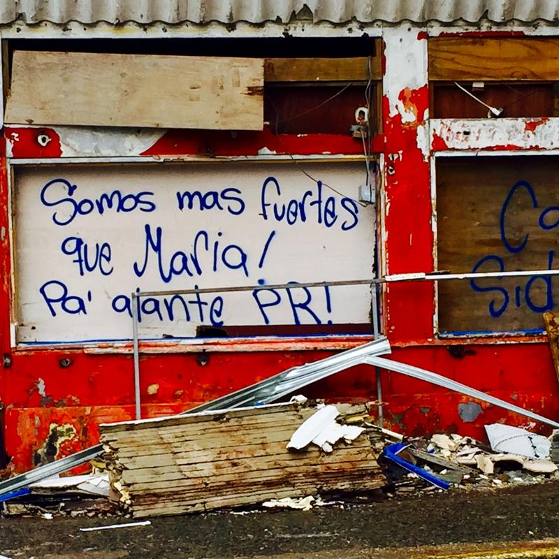 Graffiti on a wall in storm-ravaged San Juan reads: We are stronger than Hurricane Maria! Onward Puerto Rico!