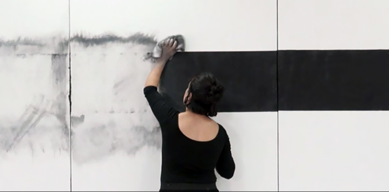 Miami-based Nathalie Alfonso washing away her own work that visibilizes invisible labor.