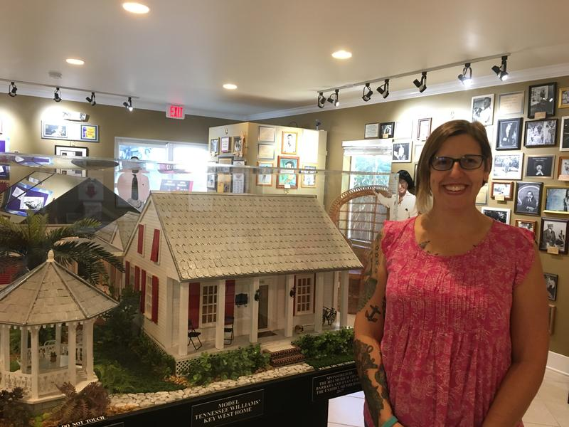 Key West Art & Historical Society Curator Cori Convertito with the new model of Tennessee Williams' Key West home, now part of the Tennessee Williams Museum.