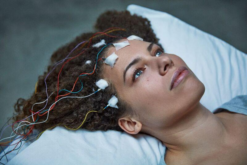 woman hooked up to sleep study wires