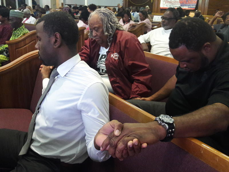 Community members in Miami pray ahead of the State of the Union address.