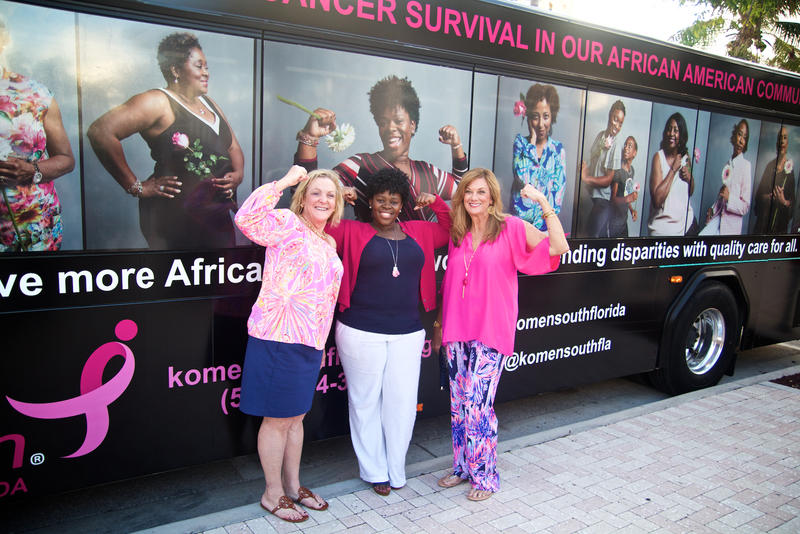 "Breast cancer survivor Tanzanika Lillard flexes in front of her portrait on the ""Shades of Pink"" bus in West Palm Beach on Jan. 11, 2018. The portraits were shot by photographer Michiko Kurisu."