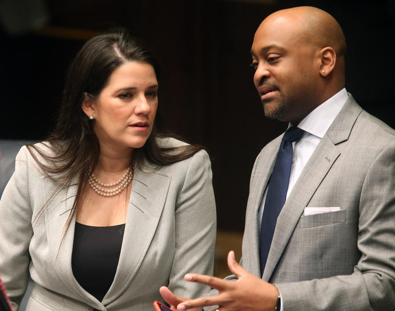 Sen. Anitere Flores, R-Miami, left, confers with Sen. Oscar Braynon, D-Miami Gardens, during the 2016 legislative session. Hours before the 2018 session began the two admitted to having an extramarital affair.
