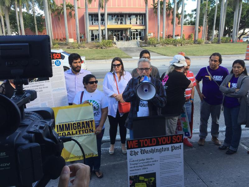 South Florida immigration activists protest Tuesday morning in front the Miami-Dade County Auditorium, where Mayor Carlos Gimenez was about to give his State of the County address.