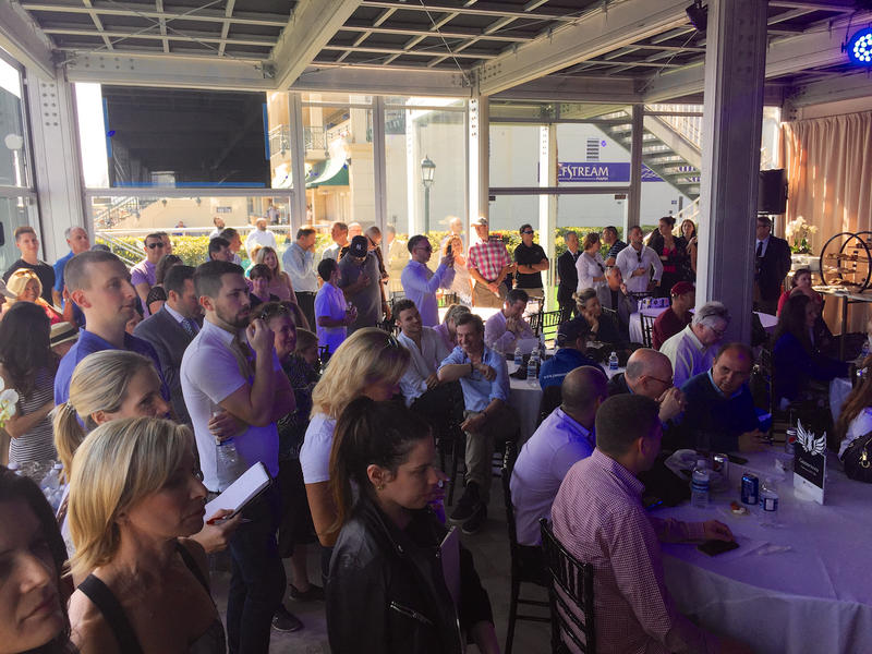 Spectators crowd the Gulfstream Park cabana for the 2018 Pegasus World Cup post position draw on Jan. 24, 2018.