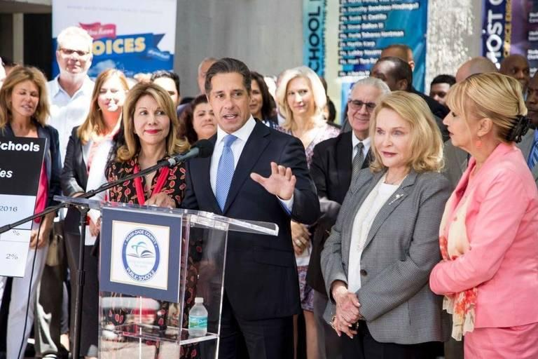 Superintendent Alberto Carvalho and several members of the Miami-Dade County school board are shown at a press conference. Carvalho and board members are weighing a property tax increase to raise money for teacher salaries.