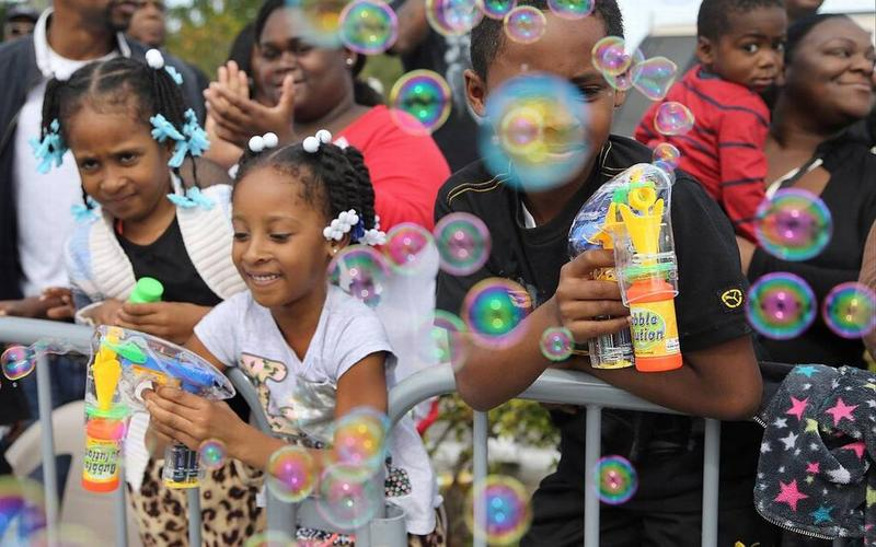Children blow bubbles on the parade route. On Monday January 18, 2016, the annual Martin Luther King, Jr. parade was held in the Liberty City in honor of the apostle of non-violence and civil rights.
