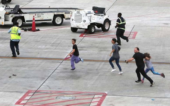 people running on airport tarmac