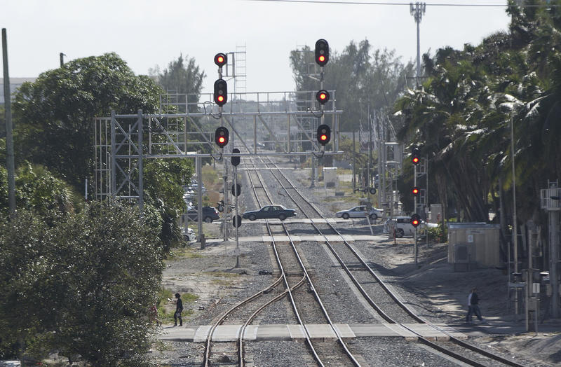 Cars cross railroad tracks next to a Brightline train station, Thursday, Jan. 11, 2018, in West Palm Beach. Trains hit three people in separate crashes at rail crossings in its first week. Two died.