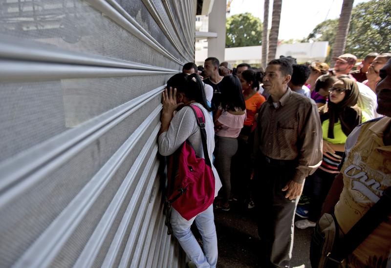 Venezuelans line up to buy scarce food last month at a supermarket in Caracas.