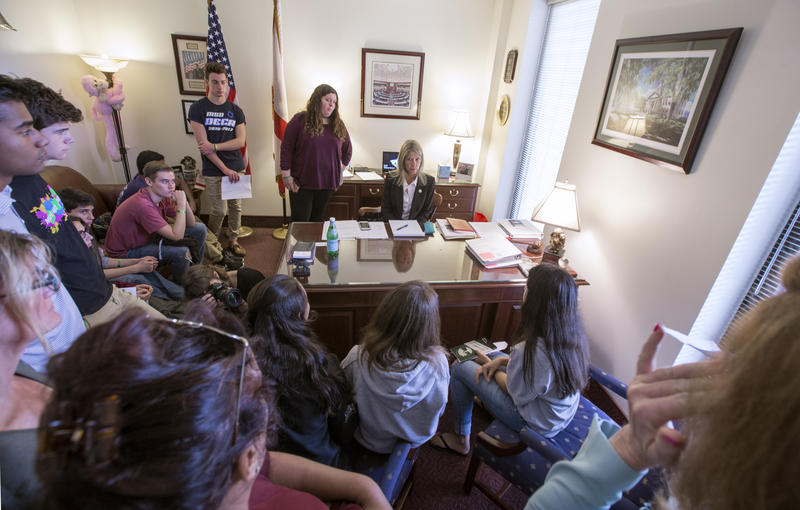 Florida Sen. Debbie Mayfield, center, listens as student survivors from Marjory Stoneman Douglas High School tell their personal experiences in her office at the Florida Capitol in Tallahassee, Fla., Feb 21, 2018.